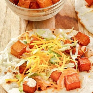 spicy potato taco with chipotle sauce, lettuce, and cheese