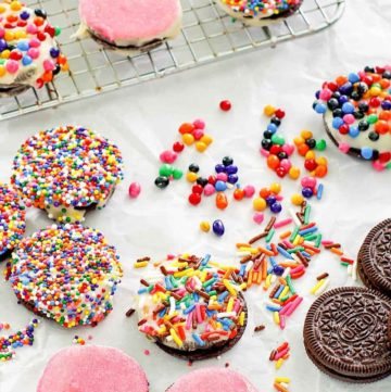 white chocolate covered oreos topped with sprinkles