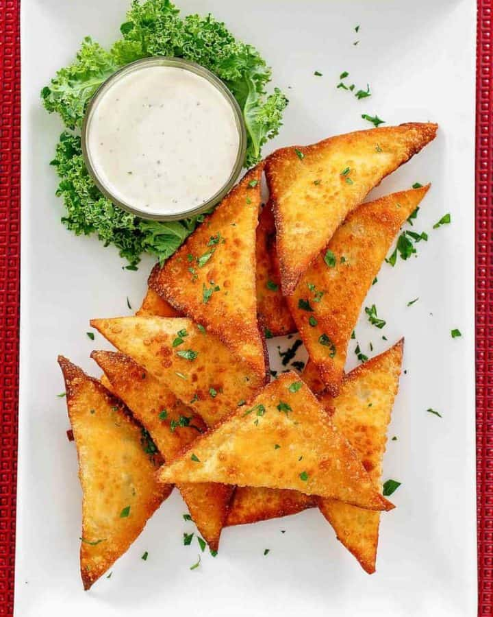 wonton jalapeno poppers and dip on a platter