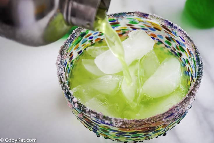 Pouring Mountain Dew Margarita into a glass