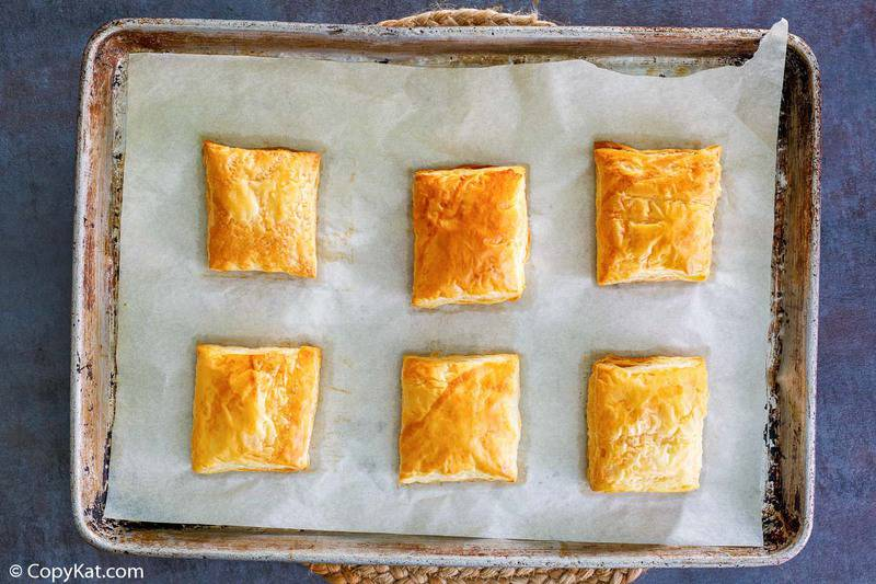 six baked puff pastry squares
