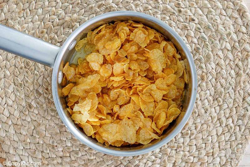 corn flakes and melted butter in a saucepan