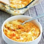 cheesy hashbrown potato casserole in a bowl and baking dish