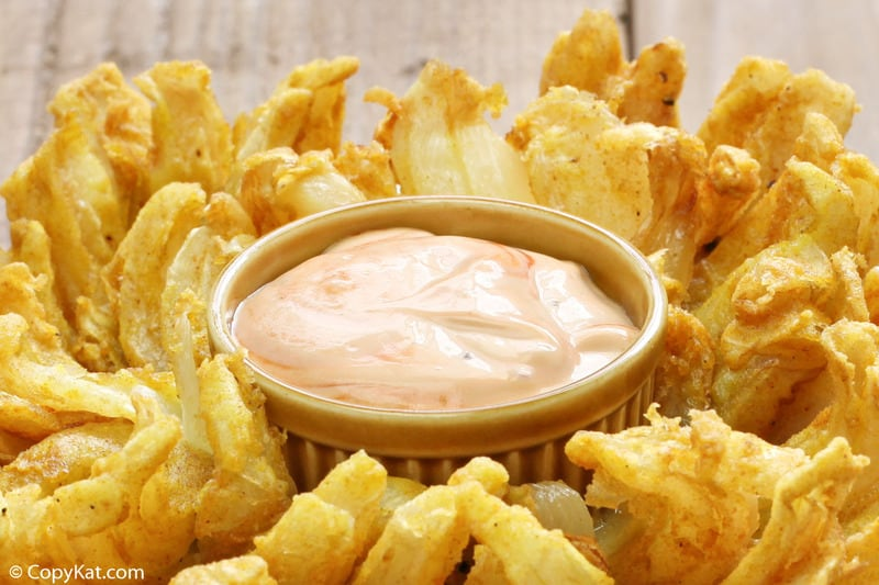 a bowl of homemade Chili's Awesome Blossom Dipping Sauce in a blooming onion