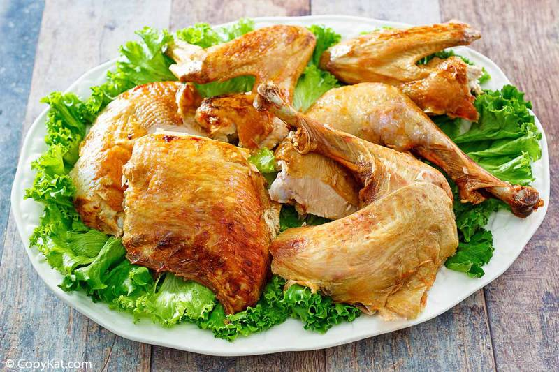 cut up deep fried turkey and lettuce on a platter