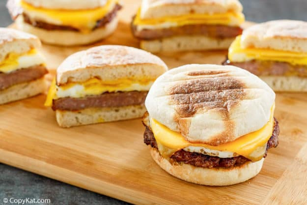 homemade McDonald's Sausage Egg McMuffin breakfast sandwiches on a wood board