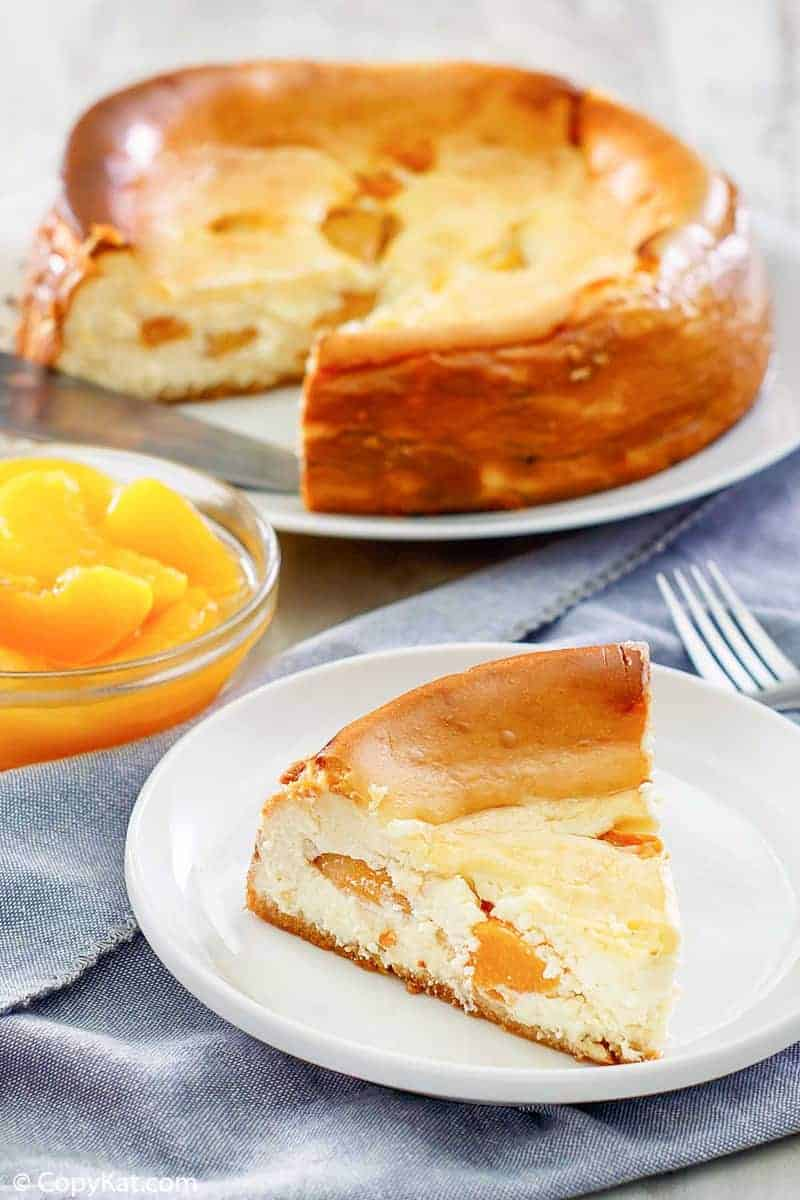homemade Olive Garden Peach Cheesecake slice on a plate