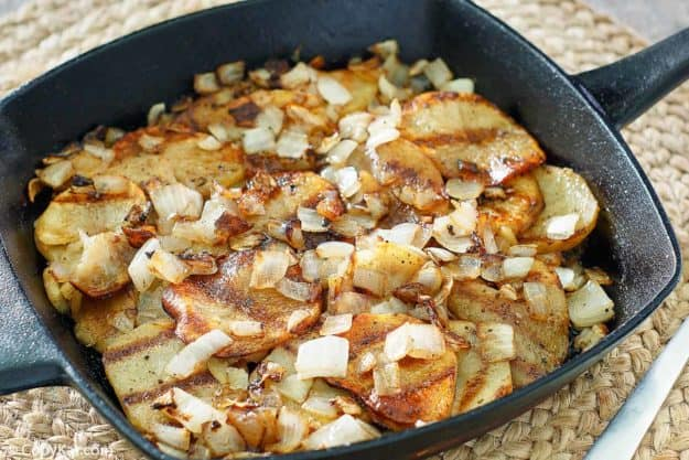 pan fried potatoes and onions in a cast iron skillet