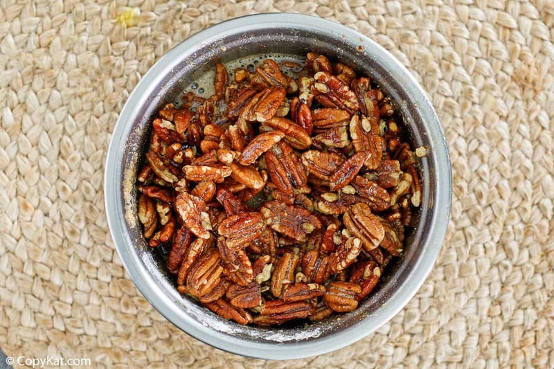 pecans and filling for pecan pie bars in a mixing bowl