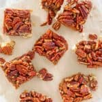 overhead view of pecan pie bars on parchment paper