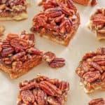 pecan pie bars on brown parchment paper