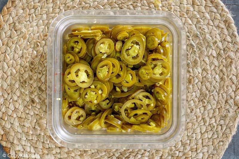 pickled jalapenos in a plastic container