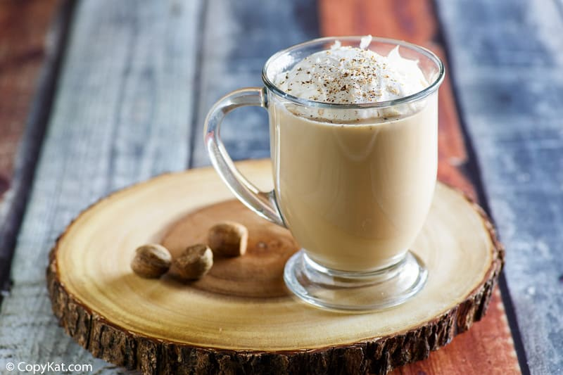 eggnog latte topped with whipped cream and nutmeg