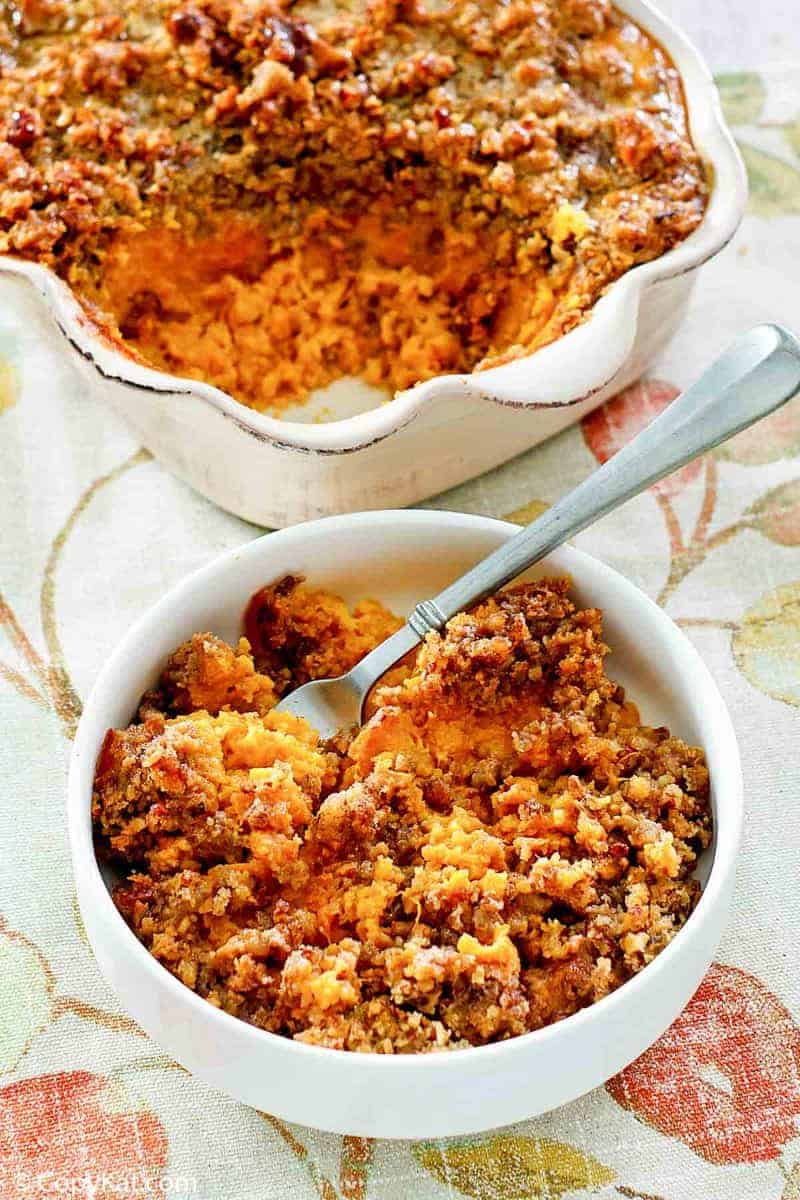 sweet potato casserole with brown sugar pecan topping in a bowl and baking dish