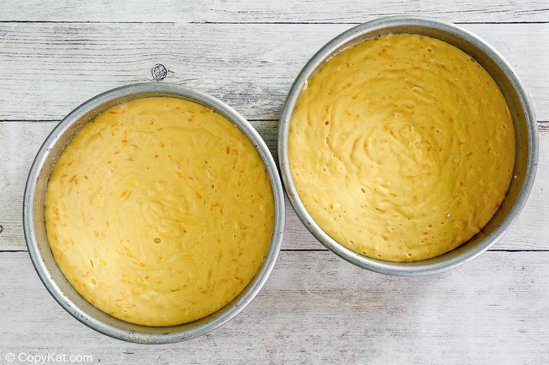 ambrosia cake layers in cake pans