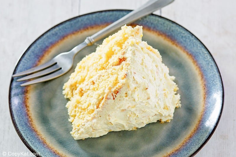 a slice of ambrosia cake and a fork on a plate