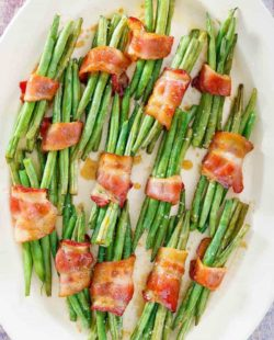 overhead view of bacon wrapped green bean bundles on a platter