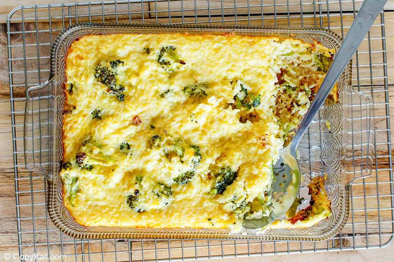 broccoli cheese rice casserole in a baking dish on top of a wire rack