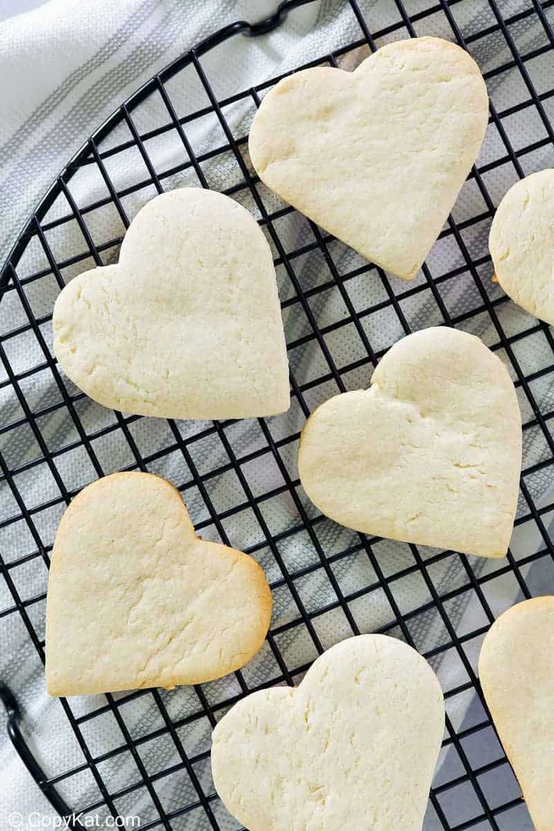 overhead view of heart-shaped cake mix cookies on a cooling rack