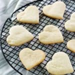 heart-shaped cake mix cookies on a round cooling rack