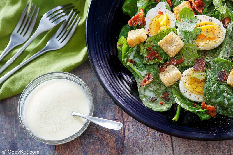 homemade Commander's Palace salad and dressing in bowls
