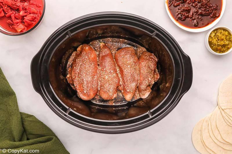 seasoned chicken breasts in a crockpot