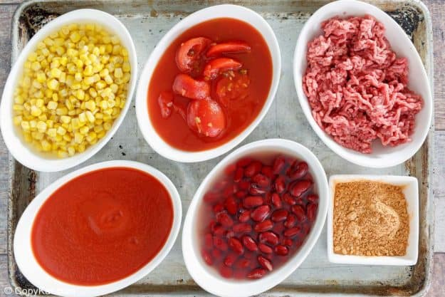 easy taco soup ingredients in bowls on a baking sheet