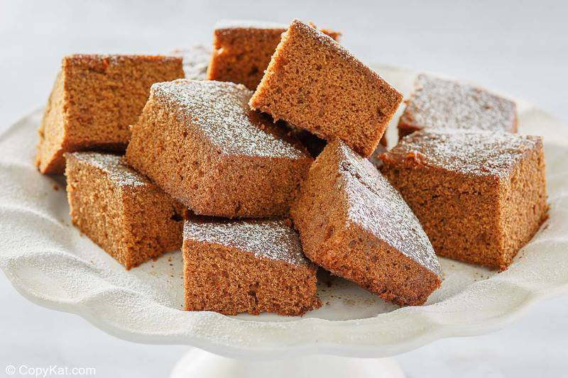 gingerbread cake slices on a white cake stand
