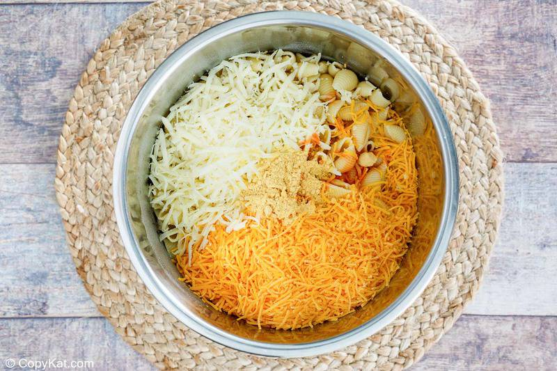cooked pasta, cheese, and seasonings in an Instant Pot bowl