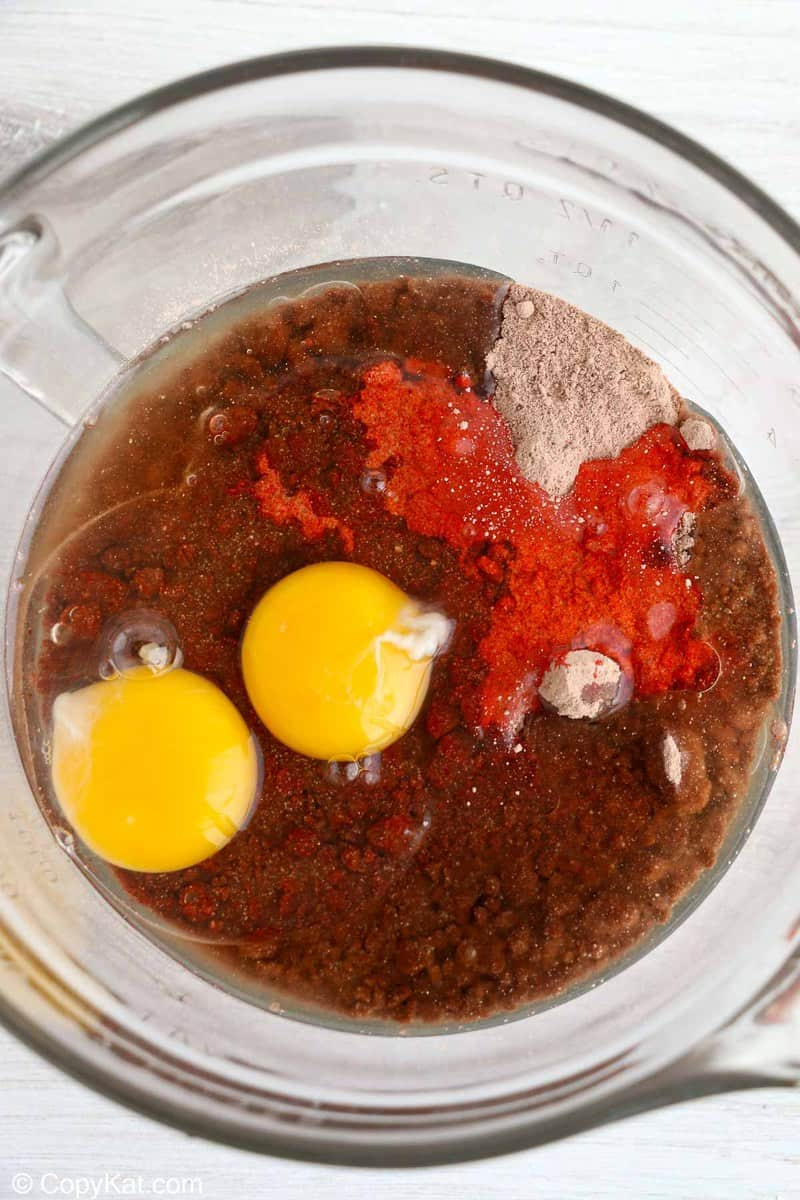 red velvet cake mix, oil, and eggs in a mixing bowl