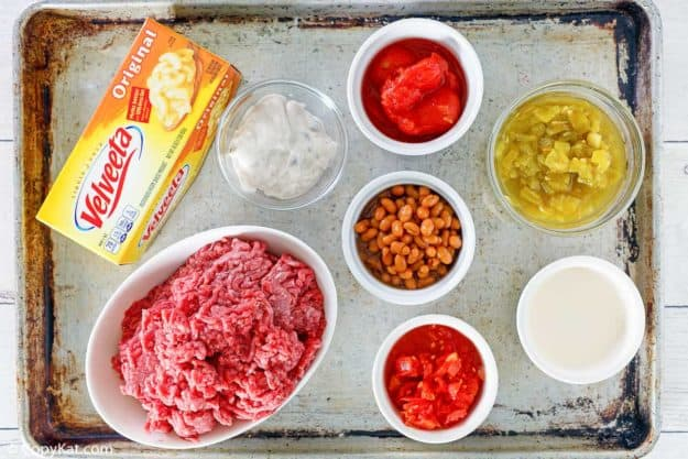 rotel dip with ground beef ingredients on a baking sheet