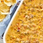 overhead view of Rotel dip with ground beef and a basket of tortilla chips