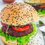 two vegan burgers with sesame seed buns