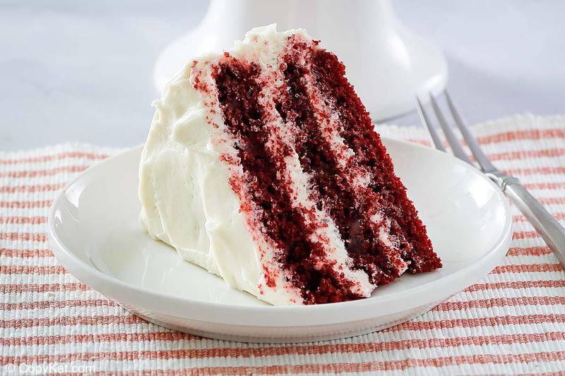 a slice of homemade Waldorf Astoria red velvet cake on a plate