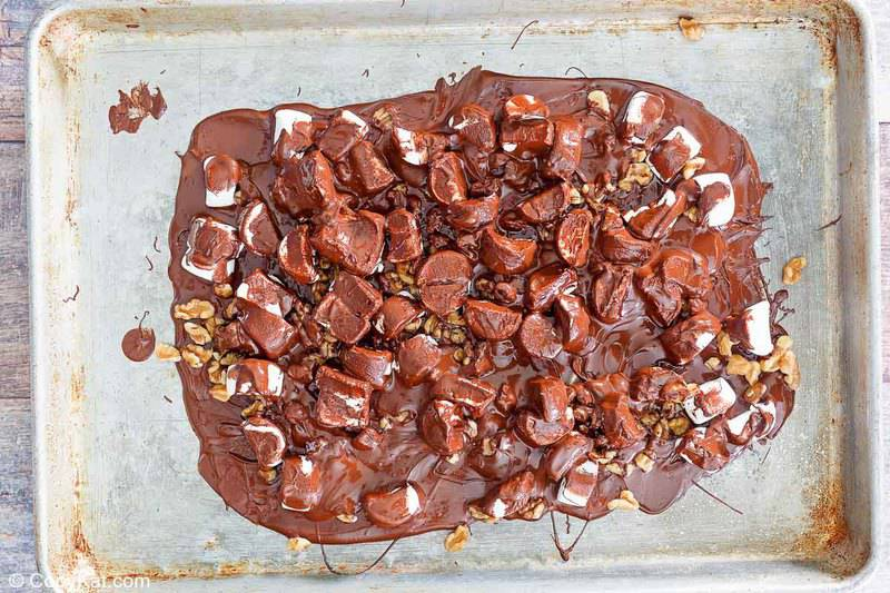 freshly made walnut rocky road candy on a baking sheet