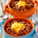 bowls of 2 alarm chili topped with cheese