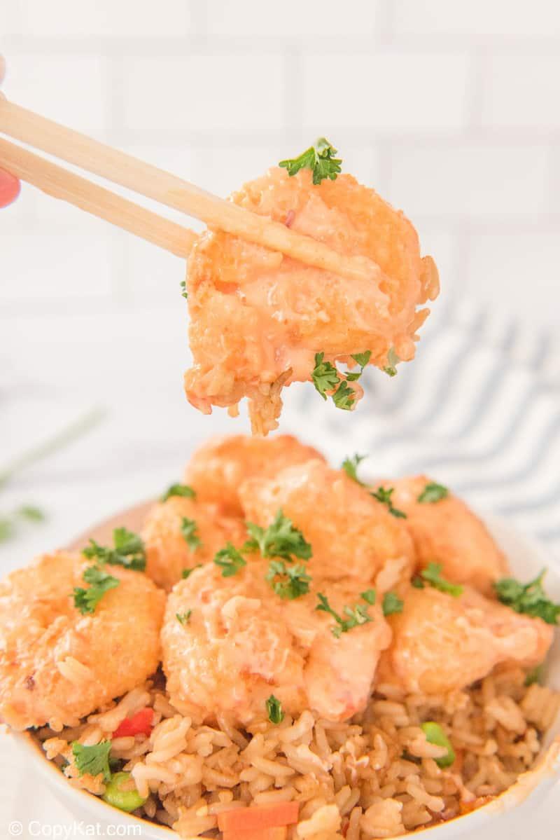 bang bang shrimp being held by chopsticks