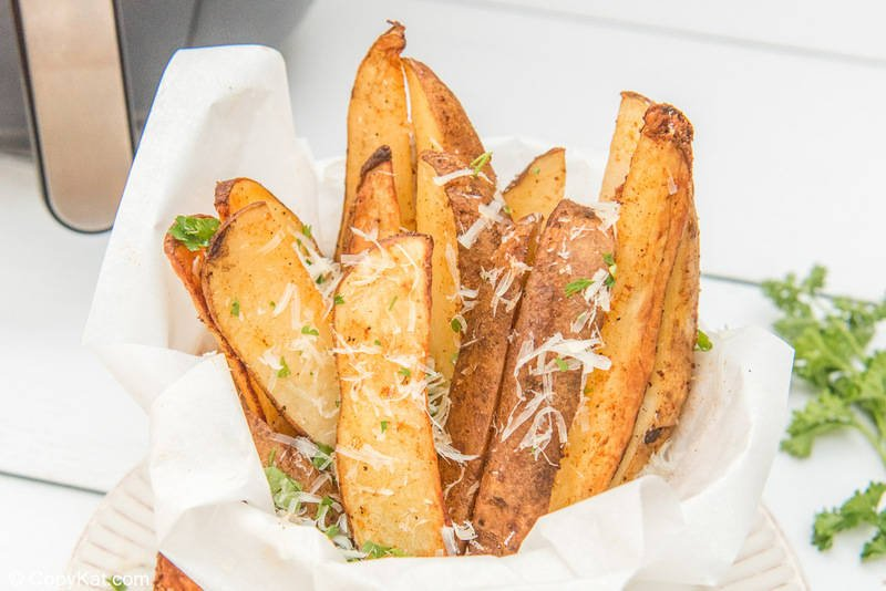 air fryer potato wedges in a serving dish