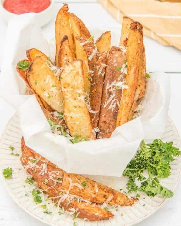 air fried potato wedges sprinkled with parmesan cheese and parsley