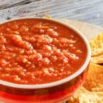 homemade Chili's salsa in a bowl and tortilla chips
