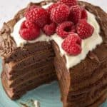 chocolate pancakes stack with a wedge cut out of it