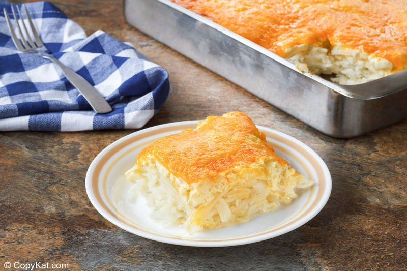 homemade Cracker Barrel hashbrown casserole on a plate and in a baking pan