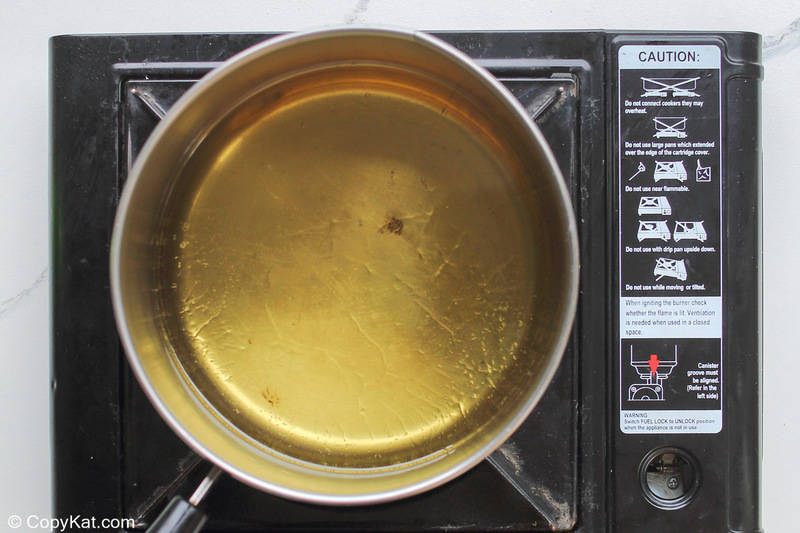vegetable oil in a pan on a cooktop
