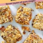 seven layer cookies on parchment paper