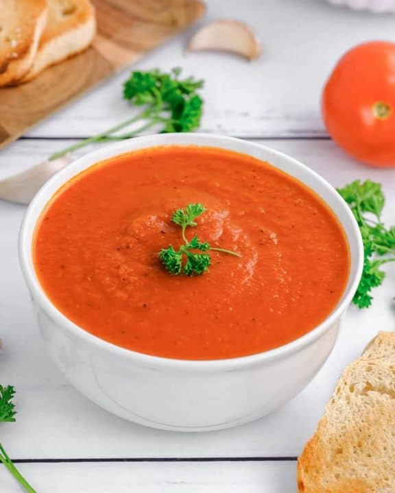 a bowl of Instant Pot Tomato soup and fresh parsley