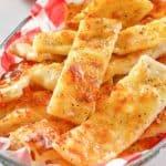 homemade Little Caesar's Italian Cheese Breadsticks in a basket