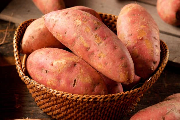 raw sweet potatoes in a basket