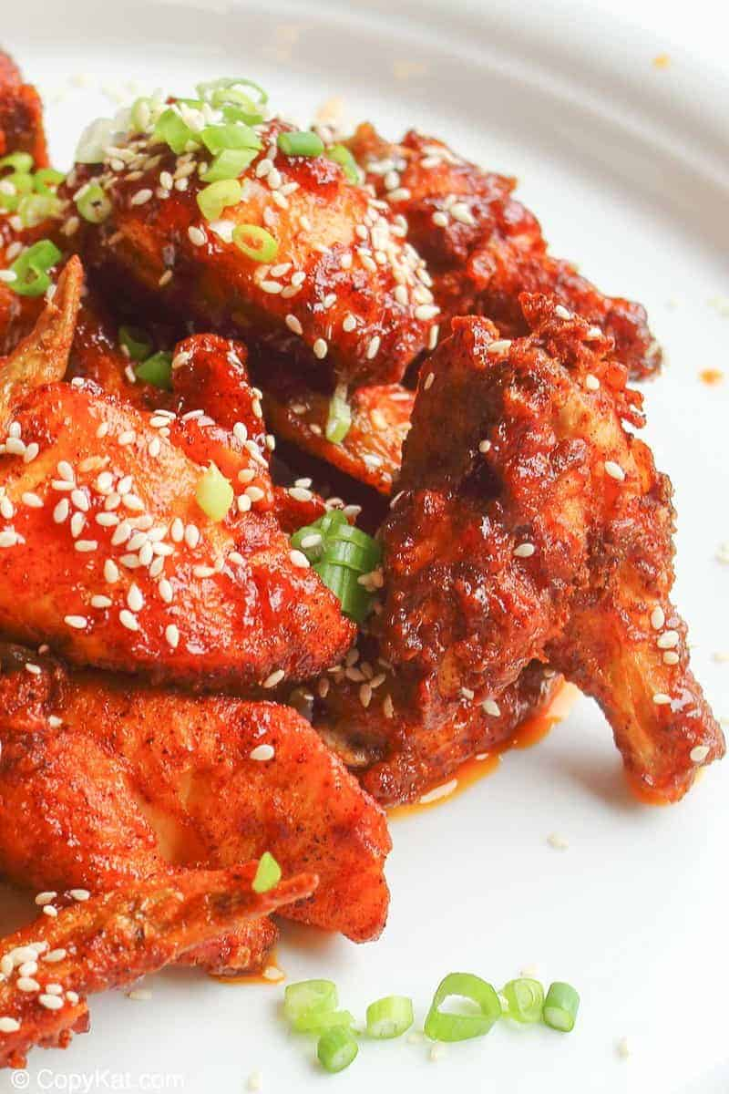 spicy chicken wings with sauce and sesame seeds on a plate