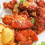 spicy chicken wings with sauce on a plate