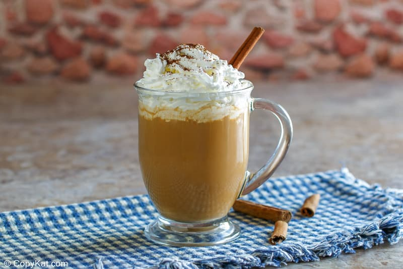homemade Starbucks pumpkin spice latte and cinnamon sticks